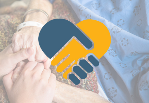 patient holding hands with loved one
