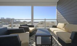 Spring is here, summer is on its way and a sun-filled balcony of the Dream Condo, overlooking the beach in Port Stanley, beckons.